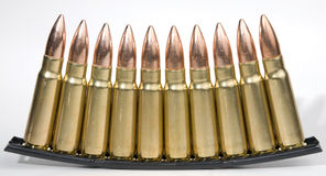 Ammo in a clip. Assault rifle bullets in a stripper clip Royalty Free Stock Photo