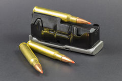 Ammo and a clip. Ammo and a gun clip Royalty Free Stock Photography