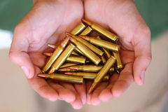 Ammo. A close up view of someone holding ammunition for a gun Royalty Free Stock Images