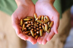 Ammo. A close up view of someone holding 380 caliber bullets Royalty Free Stock Photography