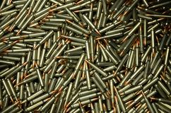 Ammo - .223 Remington, 5,56x45. A lot of 223 Remington ammo on a pile Royalty Free Stock Photo