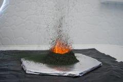 Ammonium dichromate volcano. Ammonium dichromate, experiment with fire, volcano Stock Photo