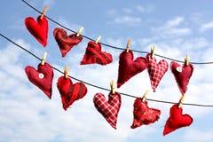 Ammortizzatori a forma di del cuore in linea Fotografia Stock