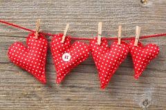 Ammortizzatori rossi a forma di del cuore Fotografia Stock Libera da Diritti