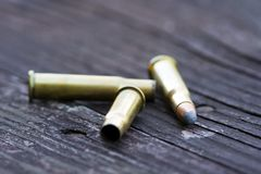 Ammunition. On a wooden shooting bench Stock Photo