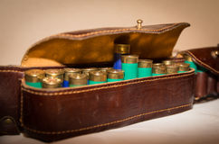Ammunition belt. An old cartridge leather belt with shotgun shells Stock Image