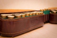 Ammunition belt. An old cartridge leather belt with shotgun shells Stock Photography