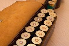 Ammunition belt. An old cartridge leather belt with shotgun shells Stock Photo