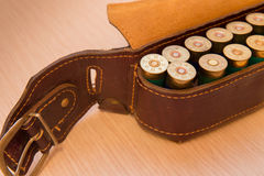 Ammunition belt. An old cartridge leather belt with shotgun shells Royalty Free Stock Photo