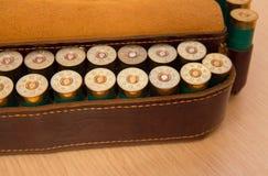 Ammunition belt. An old cartridge leather belt with shotgun shells Royalty Free Stock Photography