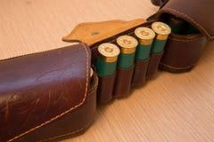 Ammunition belt. An old cartridge leather belt with shotgun shells Royalty Free Stock Photos