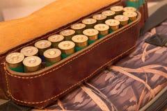 Ammunition belt. An old cartridge leather belt with shotgun shells Stock Photos