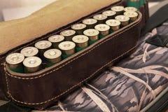Ammunition belt. An old cartridge leather belt with shotgun shells Royalty Free Stock Images