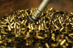 Ammunition. Brass scales on the cartridges Royalty Free Stock Images
