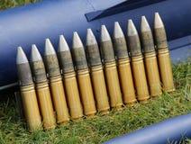 Ammunition Bullets. A Row of Heavy Duty Military Ammunition Bullets Stock Photo