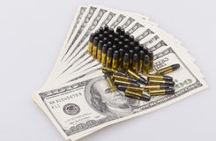 Ammunition and dollar Royalty Free Stock Photography