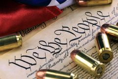 Ammunition and flag on US Constitution - History of the Second Amendment Stock Photo
