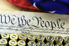 Ammunition and flag on US Constitution - History of the Second Amendment. The Second amendment to the United States Constitution provides a well regulated Stock Photography