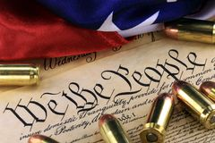 Ammunition and flag on US Constitution - History of the Second Amendment Royalty Free Stock Photo