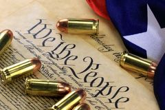 Ammunition and flag on US Constitution - History of the Second Amendment Royalty Free Stock Image