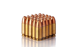 Ammunition. A group of 9mm bullets for a a gun isolated on a white background Stock Photos