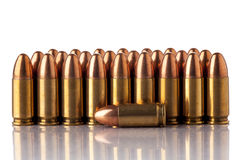 Ammunition. A group of 9mm bullets for a a gun isolated on a white background Stock Photography