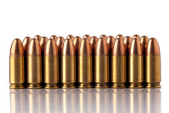 Ammunition. A group of 9mm bullets for a a gun isolated on a white background Stock Images
