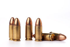 Ammunition. A group of 9mm bullets for a a gun isolated on a white background Royalty Free Stock Images