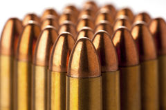 Ammunition. A group of 9mm bullets for a a gun isolated on a white background stock image