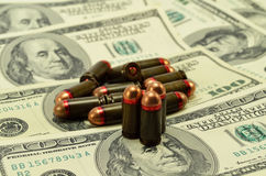 Ammunition and money Stock Image