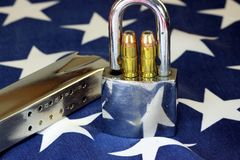 Ammunition and padlock on United States flag - Gun rights and gun control concept Royalty Free Stock Photos
