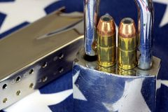 Ammunition and padlock on United States flag - Gun rights and gun control concept Stock Photography