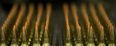 Ammunition. Red tip ammunition munition in rows Royalty Free Stock Photos