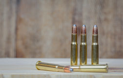 30-30 Ammunition. Rifle Ammunition with a wooden rustic background Stock Image