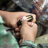 Ammunition on the soldier hands Stock Image