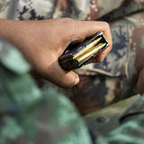 Ammunition on the soldier hands Stock Photography