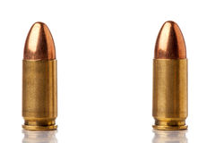 Ammunition. Two 9mm bullets for a gun isolated on a white background Royalty Free Stock Images