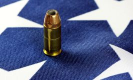 Ammunition on United States flag - Second Amendment Rights. Copper plated bullets on American flag - Second Amendment rights of firearms ownership concept Stock Photography