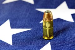 Ammunition on United States flag - Second Amendment Rights. Copper plated bullets on American flag - Second Amendment rights of firearms ownership concept Royalty Free Stock Photos