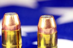 Ammunition on United States flag - Second Amendment Rights. Copper plated bullets on American flag - Second Amendment rights of firearms ownership concept Stock Photos