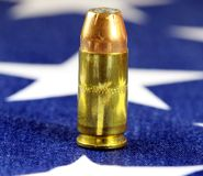 Ammunition on United States flag - Second Amendment Rights. Copper plated bullets on American flag - Second Amendment rights of firearms ownership concept Royalty Free Stock Photography