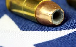 Ammunition on United States flag - Second Amendment Rights. Copper plated bullets on American flag - Second Amendment rights of firearms ownership concept Royalty Free Stock Photo