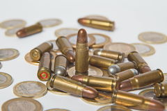 Ammunition and valid coins. Sales of weapons and ammunition. Illegal trade of ammunition Stock Image