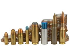 Ammunition and valid coins. Sales of weapons and ammunition. Illegal trade of ammunition. Stock Photo