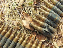 Ammunition from World War 2. Laying outside in straw stock image