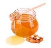 Amêndoas doces do mel Imagem de Stock Royalty Free