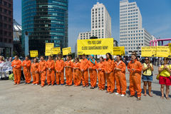 Amnesty International activists protest at Potsdamer Platz Stock Photography
