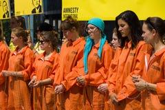 Amnesty International activists protest at Potsdamer Platz Royalty Free Stock Image