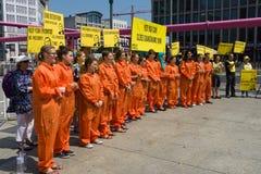Amnesty International activists protest at Potsdamer Platz Royalty Free Stock Images