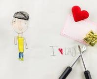 Amo al papá - el niño escribe la tarjeta Fotografía de archivo libre de regalías